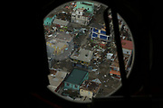 View of damage caused by Hurricane Maria in Roseau, Dominica, as seen through the window of an RAF Chinook helicoter, 20 Sept 2017.