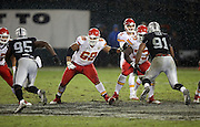 Kansas City Chiefs tackle Ryan Harris (68) and Kansas City Chiefs guard Zach Fulton (73) block Oakland Raiders defensive end Benson Mayowa (95) and Oakland Raiders defensive end Justin Tuck (91) in a driving rain during the NFL week 12 regular season football game against the Oakland Raiders on Thursday, Nov. 20, 2014 in Oakland, Calif. The Raiders won their first game of the season 24-20. ©Paul Anthony Spinelli