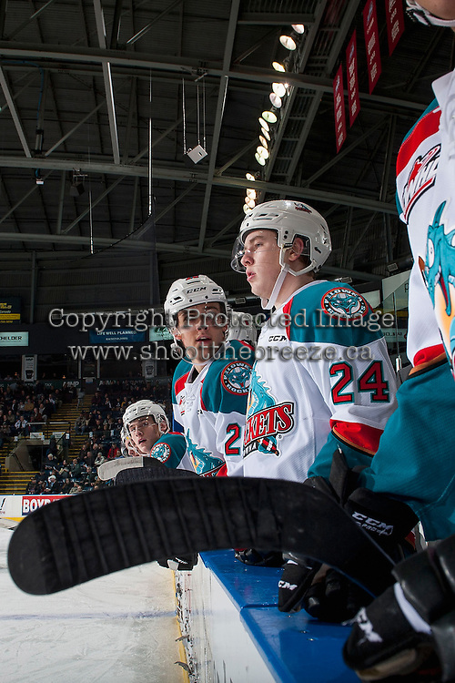 KELOWNA, CANADA - FEBRUARY 1: Leif Mattson #28 speaks to Kyle Topping #24 of the Kelowna Rockets on the bench against the Calgary Hitmen on February 1, 2017 at Prospera Place in Kelowna, British Columbia, Canada.  (Photo by Marissa Baecker/Shoot the Breeze)  *** Local Caption ***