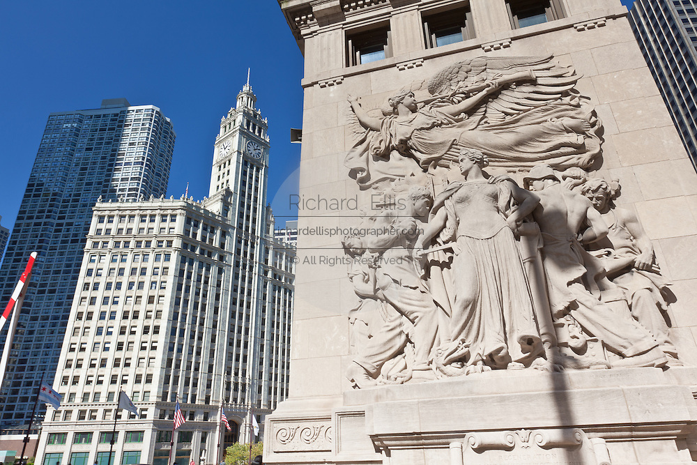 View along N Michigan Ave Bridge showing the bas relief and Wrigley Building in Chicago, IL, USA.