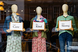 Edinburgh, Scotland, UK. 1 May 2020. Views of Edinburgh as coronavirus lockdown continues in Scotland. Streets remain deserted and shops and restaurants closed and many boarded up. Pictured; Shop window mannequins hold messages of support.   Iain Masterton/Alamy Live News