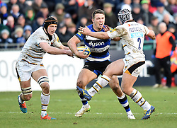 Bath Rugby centre Sam Burgess tussles with Wasps hooker Carlo Festuccia in Aviva Premiership clash at Bath's Recreation Ground - Photo mandatory by-line: Paul Knight/JMP - Mobile: 07966 386802 - 10/01/2015 - SPORT - Rugby - Bath - The Recreation Ground - Bath Rugby v Wasps - Aviva Premiership