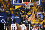 May 1, 2018; Oakland, CA, USA; Golden State Warriors guard Stephen Curry (30) shoots the basketball against New Orleans Pelicans forward Solomon Hill (44) and guard Ian Clark (2) during the second quarter in game two of the second round of the 2018 NBA Playoffs at Oracle Arena.