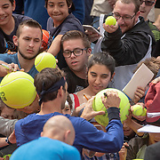 PARIS, FRANCE May 25. Roger Federer of Switzerland signing autographs on Court Suzanne Lenglen in preparation for the 2019 French Open Tennis Tournament at Roland Garros on May 25th 2019 in Paris, France. (Photo by Tim Clayton/Corbis via Getty Images)