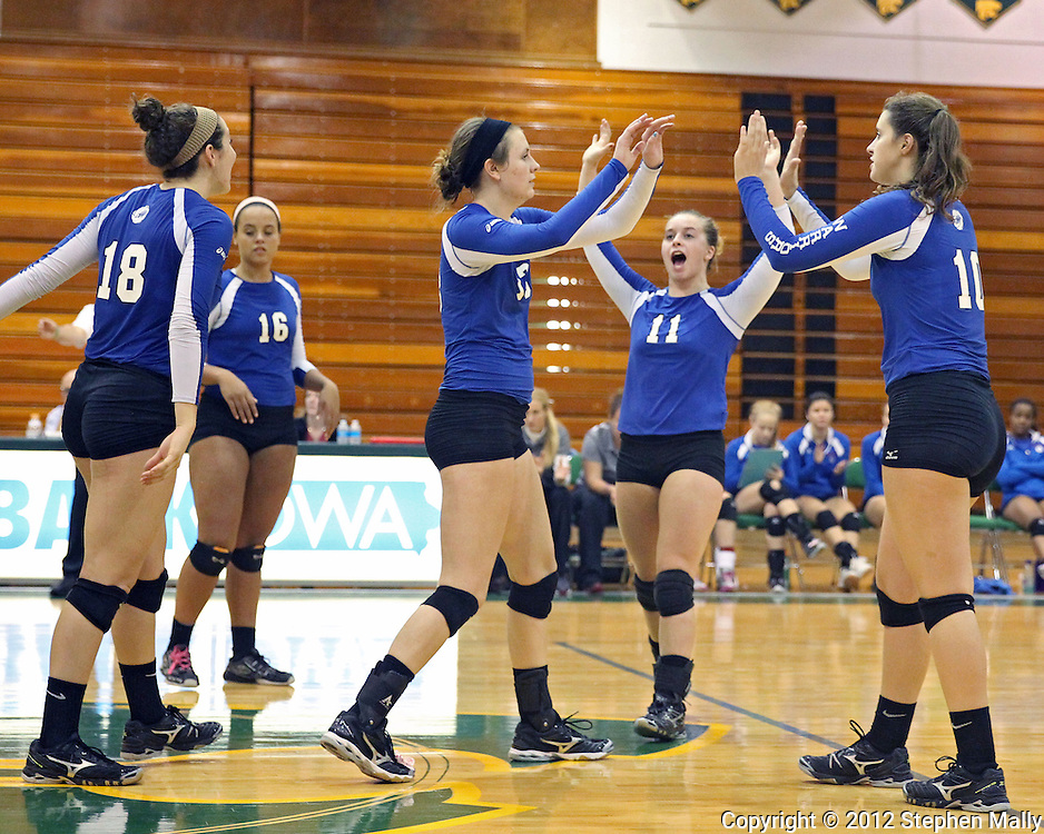 Washington's Shanay Gonder (18), Aleena Hobbs (16), Kellie Walters (13), Hanna Reese (11), and Danielle Franklin (10) celebrate a score during the MVC Volleyball Tournament Championship game between the Hempstead Mustangs and the Washington Warriors at Kennedy High School in Cedar Rapids on Saturday October 13, 2012. Hempstead defeated Washington 25-21 25-19.