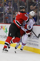 Jan 31; Newark, NJ, USA; New Jersey Devils defenseman Adam Larsson (5) hits New York Rangers left wing Carl Hagelin (62) during the first period at the Prudential Center.