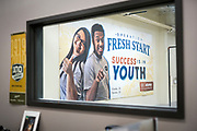 Operation Fresh Start posters are seen on the walls of the construction and conservation lab during the grand opening ceremony for Operation Fresh Start on Milwaukee Street in Madison, WI on Thursday, April 11, 2019.