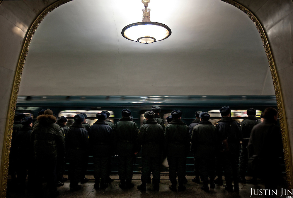 Soldiers wait for a train at the Kievskaya metro station on the Moscow ring line. .The Moscow Metro, which spans almost the entire Russian capital, is the world's second most heavily used metro system after the Tokyo's twin subway. Opened in 1935, it is well known for the ornate design of many of its stations, which contain outstanding examples of socialist realist art.