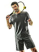one caucasian mature tennis player man in studio isolated on white background