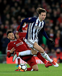 Liverpool's Alex Oxlade-Chamberlain (left) and West Bromwich Albion's Grzegorz Krychowiak (right) battle for the ball during the Emirates FA Cup, fourth round match at Anfield, Liverpool.