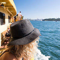 A woman on a ferry in Sydney Harbour.