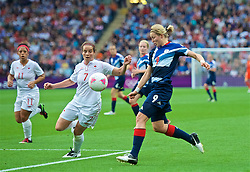 COVENTRY, ENGLAND - Friday, August 3, 2012: Great Britain's Ellen White (R) and Canada's Rhian Wilkinson during the Women's Football Quarter-Final match between Great Britain and Canada, on Day 7 of the London 2012 Olympic Games at the Rioch Arena. Canada won 2-0. (Photo by David Rawcliffe/Propaganda)