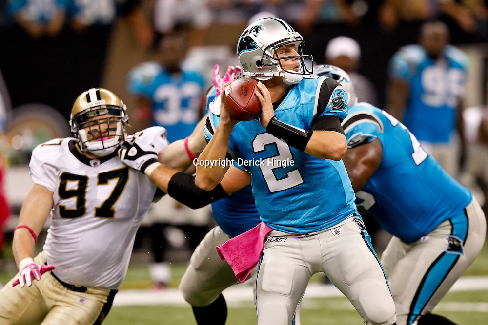 October 3, 2010; New Orleans, LA, USA; Carolina Panthers quarterback Jimmy Clausen (2) passes the ball against the New Orleans Saints during a game at the Louisiana Superdome. The Saints defeated the Panthers 16-14. Mandatory Credit: Derick E. Hingle