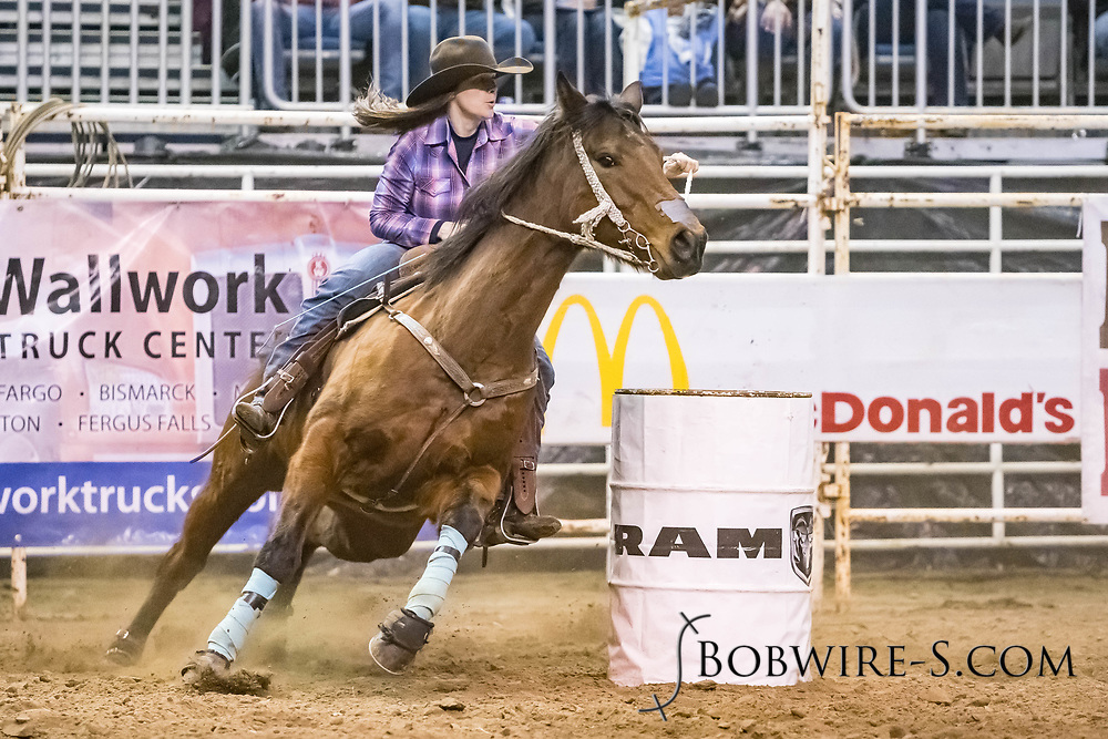 Kaylee Gallino makes her barrel run at the Bismarck Rodeo on Friday, Feb. 2, 2018. She won the rodeo with a 12.80.
