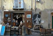 Naples, Italy, Nov 2006-Shop with graffiti in Spaccanapoli.