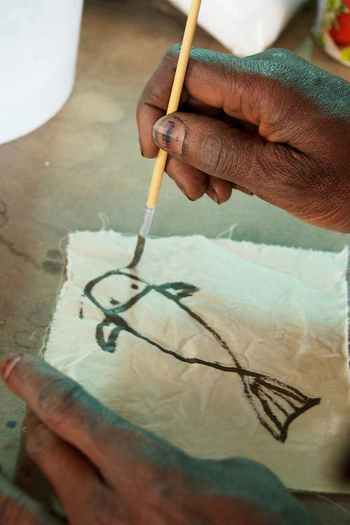 Aboubakar Fofant demonstrates painting with mud onto mordanted cloth. Indigo dye and bogolan workshop held with Aboubakar Fofana in Johannesburg, South Africa