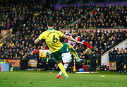 Sheffield United's Leon Clarke gets a shot in despite close attention from Norwich City's Christoph Zimmermann during the EFL Sky Bet Championship match between Norwich City and Sheffield Utd at Carrow Road, Norwich, England on 20 January 2018. Photo by John Marsh.