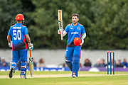 Rahmat Shah (#08) acknowledges the crowd as he makes 100 runs during the One Day International match between Scotland and Afghanistan at The Grange Cricket Club, Edinburgh, Scotland on 10 May 2019.