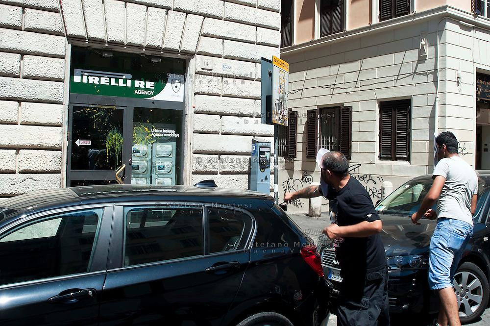 Roma 22 Giugno 2012.Manifestazione  dei sindacati di base contro le politiche economiche e sociali del Governo Monti..L'agenzia immobiliare Pirelli Re colpita dal lancio delle uova dei manifestanti