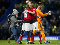 Manchester United's Ashley Young (left) and Nemanja Matic celebrate after the final whistle during the FA Cup fifth round match at Stamford Bridge, London.