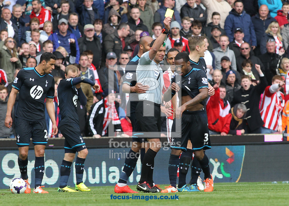 Danny Rose of Tottenham Hotspur is booked by referee Andre Marriner during the Barclays Premier League match against Stoke City at the Britannia Stadium, Stoke-on-Trent.<br /> Picture by Michael Sedgwick/Focus Images Ltd +44 7900 363072<br /> 26/04/2014