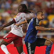 Péguy Luyindula, (left), New York Red Bulls, challenges Khari Stephenson, San Jose Earthquakes, during the New York Red Bulls Vs San Jose Earthquakes, Major League Soccer regular season match at Red Bull Arena, Harrison, New Jersey. USA. 19th July 2014. Photo Tim Clayton