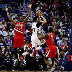 Mar 18, 2016; New Orleans, LA, USA; New Orleans Pelicans forward Anthony Davis (23) shoots over Portland Trail Blazers forward Al-Farouq Aminu (8) and forward Noah Vonleh (21) during the first quarter of a game at the Smoothie King Center. Mandatory Credit: Derick E. Hingle-USA TODAY Sports