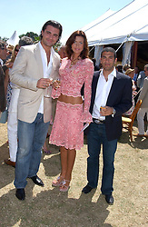 Left to right, singer DARIUS DANESH, NATALIYA PETOUCHKOVA and SIMON KASSIANIDES at the Veuve Clicquot sponsored Gold Cup Final or the British Open Polo Championship held at Cowdray Park, West Sussex on 17th July 2005.<br />