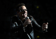 PERTH, AUSTRALIA - DECEMBER 18:  Bono of U2 performs on stage in concert during the Perth leg of their 360 degree Tour at Patersons Stadium on December 18, 2010 in Perth, Australia.  (Photo by Paul Kane/Getty Images)