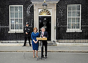 Gordon Brown announces his resignation on Downing Street as Britain's Prime Minister before visiting Queen Elizabeth II to inform her of his decision.