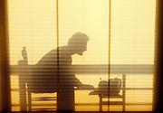 Man typing at typewriter.