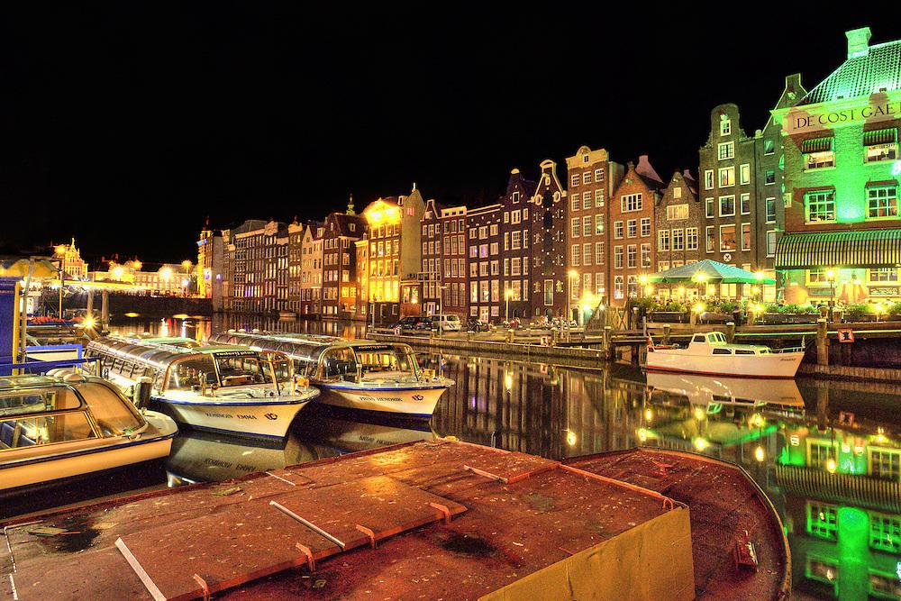 Boats docked in Amsterdam harbor, Amsterdam Netherlands