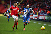 Blackburn Rovers striker, Danny Graham (12) battling fot ball with Charlton Athletic defender, Jorge Teixeira (50) during the Sky Bet Championship match between Charlton Athletic and Blackburn Rovers at The Valley, London, England on 23 January 2016. Photo by Matthew Redman.