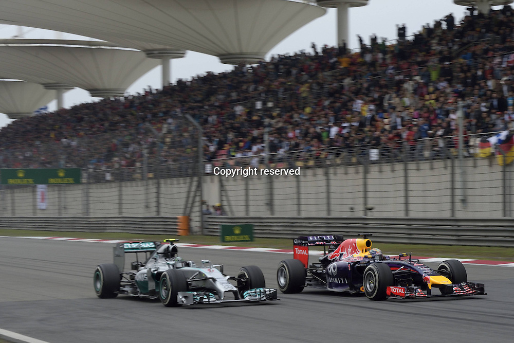 20.04.2014. SHanghai, China.  Motorsports: FIA Formula One World Championship 2014, Grand Prix of China, 6 Nico Rosberg (GER, Mercedes AMG Petronas F1 Team), 1 Sebastian Vettel (GER, Infiniti Red Bull Racing)