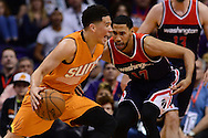 Apr 1, 2016; Phoenix, AZ, USA; Phoenix Suns guard Devin Booker (1) handles the ball against Washington Wizards guard Garrett Temple (17) in the first half at Talking Stick Resort Arena. Mandatory Credit: Jennifer Stewart-USA TODAY Sports