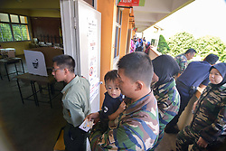 59583834  .Soldiers wait in line to cast their votes during early polling of the 13th general elections at an army base in Kuala Lumpur, capital of Malaysia, April 30, 2013. Malaysia held early polling on Tuesday for police and servicemen days before the polling day for the closest election ever in the country, on 30, April. Photo by: i-Images.UK ONLY