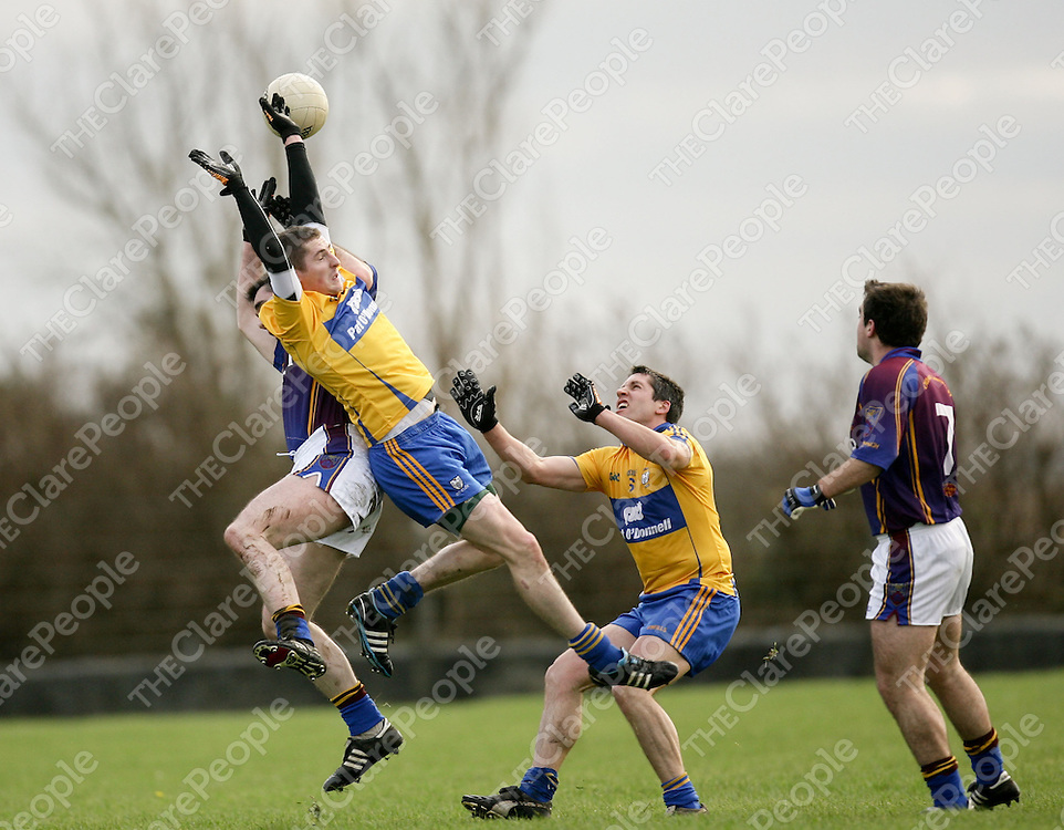 08.01.12<br /> McGrath Cup Football 2012, Clare verses UL, Doonbeg Co. Clare. Clare's Graham Kelly in action against Ul's David Niblock. Pic Alan Place Press 22.
