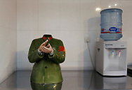 A modern take on Mao's red guards crafted in porcelain sits next to a water cooler at a cafe in Beijng's art district, China, Tuesday, Dec.16, 2008. Before the economic reforms, art in communist China was limited mostly to propaganda. Now propaganda items are sold as Communist kitsch and the scene is vibrant following a revival thanks to the 1978 reforms allowing for more personal freedoms. Now Chinese artists are feted by the international art scene, and their work sells in the million of dollars.<br />  (AP Photo/ Elizabeth Dalziel)