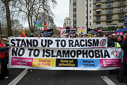 © Licensed to London News Pictures. 16/03/2019. LONDON, UK. People carry banners at the head of the march. Thousands of people take part in a Stand Up To Racism and Stand Up To Islamophobia march through the capital.  Photo credit: Stephen Chung/LNP