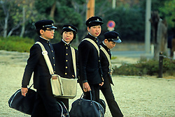 High School Kids Walking To School carrying school bags and in uniforms, Tokyo, Japan