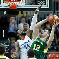 02 August 2012: Lithuania Antanas Kavaliauskas goes to the basket against Ronny Turiaf of France during 82-74 Team France victory over Team Lithuania, during the men's basketball preliminary, at the Basketball Arena, in London, Great Britain.