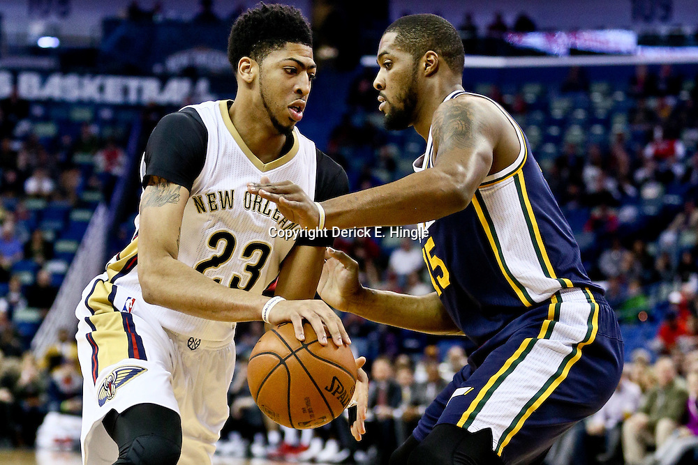 Feb 10, 2016; New Orleans, LA, USA; New Orleans Pelicans forward Anthony Davis (23) drives past Utah Jazz forward Derrick Favors (15) during the first quarter of a game at the Smoothie King Center. Mandatory Credit: Derick E. Hingle-USA TODAY Sports
