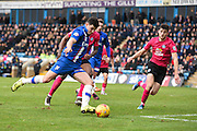 Gillingham defender John Egan shoots at goal from close range during the Sky Bet League 1 match between Gillingham and Peterborough United at the MEMS Priestfield Stadium, Gillingham, England on 23 January 2016. Photo by David Charbit.