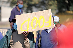 RUSTENBURG SOUTH AFRICA - MAY 18: A protester with a placard on May 18, 2020, in Rustenburg, South Africa. Seraleng residents gathered at Sibanye k5 mine shaft Communities in the area alleged complaints of food parcel corruption by a local ward councillor. Grievances also included concerns with unemployment, loss of business and access to a social labour plan. (Photo by Gallo Images/Dino Lloyd)
