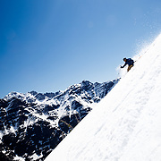 Griffin Post skiing a backcountry line in Glacier National Park.