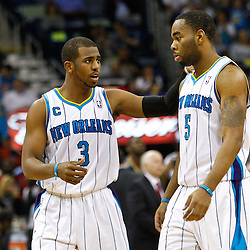 February 1, 2011; New Orleans, LA, USA; New Orleans Hornets point guard Chris Paul (3) talks with guard Marcus Thornton (5) during the second half of a game against the Washington Wizards at the New Orleans Arena. The Hornets defeated the Wizards 97-89.  Mandatory Credit: Derick E. Hingle