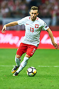 Warsaw, Poland - 2017 September 04: Maciej Rybus from Poland controls the ball during soccer match Poland v Kazakhstan - FIFA 2018 World Cup Qualifier at PGE National Stadium on September 04, 2017 in Warsaw, Poland.<br /> <br /> Adam Nurkiewicz declares that he has no rights to the image of people at the photographs of his authorship.<br /> <br /> Picture also available in RAW (NEF) or TIFF format on special request.<br /> <br /> Any editorial, commercial or promotional use requires written permission from the author of image.<br /> <br /> Mandatory credit:<br /> Photo by &copy; Adam Nurkiewicz / Mediasport