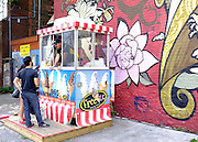 © Licensed to London News Pictures. 03/08/2012. Toronto, UK An ice cream seller in Kensington, Toronto. Photo credit : Stephen Simpson/LNP