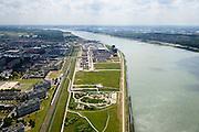 Nederland, Zuid-Holland, Rotterdam, 10-06-2015; flats aan de Merellaan in Massluis, ter hooge van NS sation Maassluis-West. Rechts rivier Het Scheur (abusievelijk ook Nieuwe Waterweg).<br /> Residential apartment overlooking entrance to Port of Rotterdam.<br /> <br /> luchtfoto (toeslag op standard tarieven);<br /> aerial photo (additional fee required);<br /> copyright foto/photo Siebe Swart
