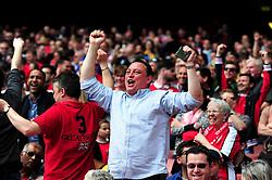Arsenal fans celebrate as Tottenham Hotspur concede  a goal - Mandatory by-line: Dougie Allward/JMP - 15/05/2016 - FOOTBALL - Emirates Stadium - London, England - Arsenal v Aston Villa - Barclays Premier League